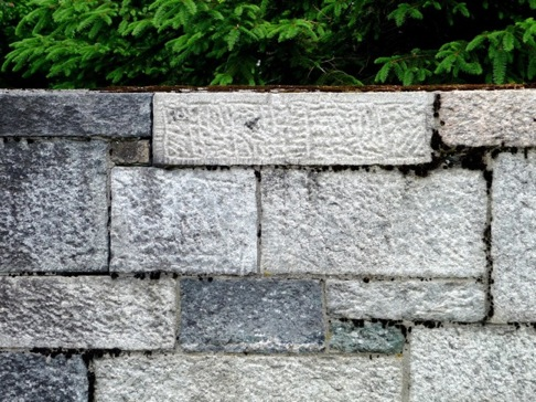 Dressed granite wall, solidly built with care, skill, and a good level